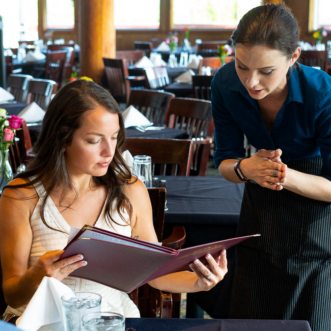 young woman ordering from menu